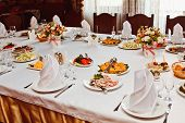 Постер, плакат: Elegant Beautiful Decorated Table With Meals And Tableware At Wedding Reception Closeup