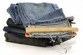 stack of jeans and one with a clothes hanger