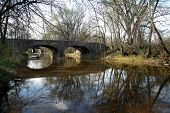 stock photo of stagecoach  - Historic Stone bridge over Mankser Creek near Nashville Tennessee this was originally built for stagecoach travel but is still used for Autos today - JPG