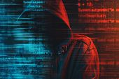 Stereotypical Image Of Computer Hacker With Hoodie And Computer Code. Faceless Hooded Male Person Li poster