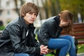 problem depression relationship difficulties of young couple people in outdoors