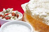 Poppadoms With Onion Salad And Mint Raita