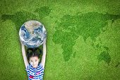 Earth Day, Ecological Friendly And Corporate Social Responsibility Concept With Kid Raising World On poster