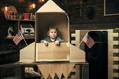 Kids Playing With Toys. Boy Play With Rocket, Cosmonaut Sit In Usa Rocket Made Out Of Cardboard Box. poster