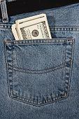 Dollars in hip-pocket of jeans