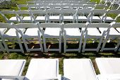 Rows Of White Chairs Outdoors For Ceremony