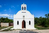 Generic Small Old Church On Silba Island In Croatia. Small White Church With Bells, Doors And Window poster