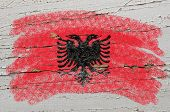 Flag Of Albania On Grunge Wooden Texture Painted With Chalk