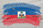 Flag Of Haiti On Grunge Wooden Texture Painted With Chalk
