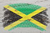 Flag Of Jamaica On Grunge Wooden Texture Painted With Chalk
