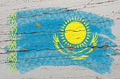 Flag Of Khazakstan On Grunge Wooden Texture Painted With Chalk