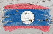 Flag Of Laos On Grunge Wooden Texture Painted With Chalk