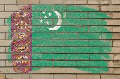 Flag Of Turkmenistan On Grunge Brick Wall Painted With Chalk