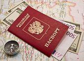 Passport with money,compass, map