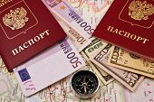 Two Passport With Money And Compass
