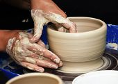 picture of molding clay  - The process of creating pottery by hand - JPG