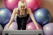 Woman Athlete Keep Arms Straight On Stepper In Gym With Colorful Fit Balls. Endurance, Strength And  poster