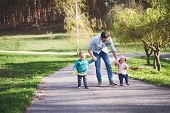 A Father With His Two Toddler Children Outside On A Sunny Spring Walk. poster