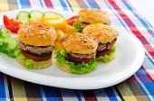 Plate with tasty mini burgers