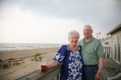 image of soulmate  - Happy senior couple on vacation overlooking the beach and ocean - JPG