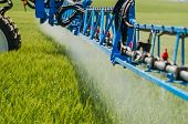 Agricultural Sprayers, Spray Chemicals On Young Wheat.spraying Pesticides On Wheat Field With Spraye poster