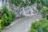 Mountain Gorge With A River Below. Canyon Of Mountain River On Steep Slopes, Misty Canyon, Flashy Ri poster