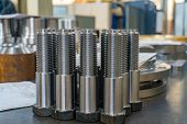 Bolts Machined On A Lathe From A Hexagon In The Machine Shop. poster