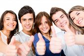 Group of young people with thumbs up - isolated over a white background