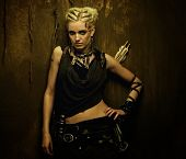 image of doomsday  - Girl with a quiver against grunge wall - JPG