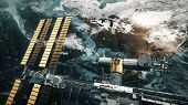 ISS with solar panel revolve over Earth atmosphere. International Space Station orbiting planet. Rea poster