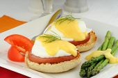 stock photo of benediction  - Delicious eggs benedict served with fresh vegetables - JPG