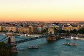 Scenic Evening View Of Budapest. One Of The Main Attractions Is Ancient Chain Bridge Over Danube Riv poster