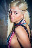 Portrait of beautiful young woman in beads