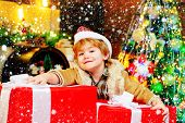 Gift Kid Emotions. New Year Christmas Concept. Happy Kid Having Fun With Big Gift Box. Kid Having Fu poster