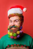 Santa Claus Man With Decorated Beard. Smiling Bearded Man In Santa Hat. Christmas Beard Decorations. poster