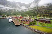 FLAM - JULE 25: Sognefjord port and railway station near wooded mountain on Jule 25, 2011 in Flam, N