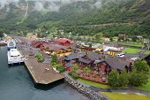 FLAM - JULE 25: Sognefjord port and railway station near picturesque mountain on Jule 25, 2011 in Fl