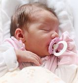 picture of cute little girl  - Cute baby sleeping on the bed - JPG