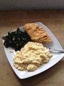 Chilli Humous on crusty bread, saute'd curly cale and creamy scrambled eggs...