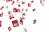 Red sale tags in bright white space.