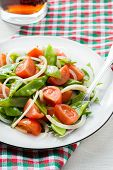 Fresh snow peas and tomato salad on plate
