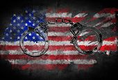 Handcuffs And Flag Of United States