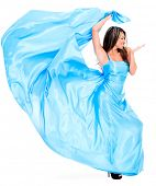 Woman in a beautiful long blue dress - isolated over white background
