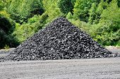 stock photo of nonrenewable  - A Small Stock Pile of Lump Coal - JPG