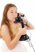 Young red headed child talking on a vintage telephone