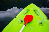 Green Kayak With Red Oar