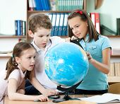 stock photo of intercourse  - Pupils find something at the school globe - JPG