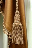 image of tassels  - Close up golden color elegance curtain tassel - JPG