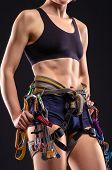 female body in climbing equipment