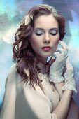 stock photo of irresistible  - Portrait of young glamourous woman on sparkling background in old Hollywood style - JPG
